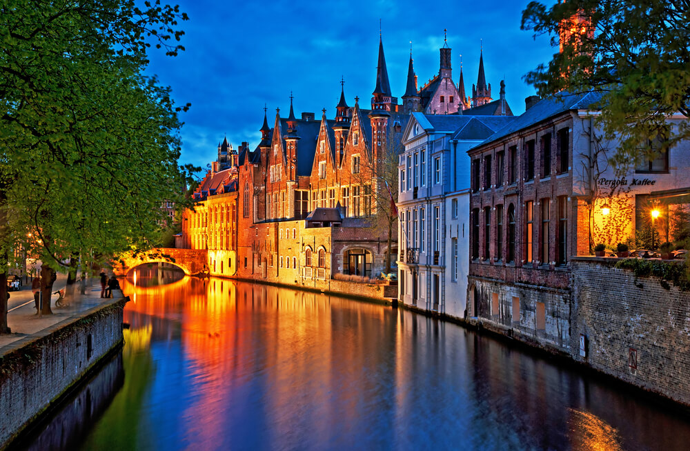 Night Shot of Historic Medieval Buildings along a Canal in Bruges - Belgium