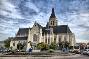 Church and the statue of horse in the centre of Vilvoorde - city near Brussels, Belgium