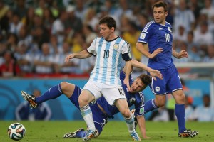 Messi of Argentina and Bicakcic of Bosnia compete for the ball during the World Cup 2014
