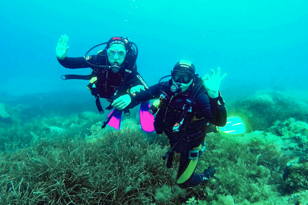 A Couple Enjoying Scuba Diving In Greece