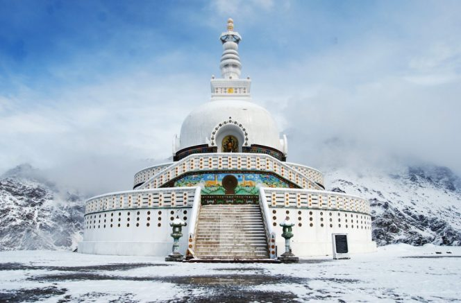 Shanti Stupa a remote place of worship with a large golden statue of the Buddha